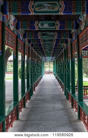 Covered Walkway In Old Traditional Park In Beijing,  China