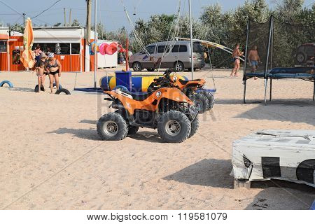 Russia Achuevo - August 2 2015: ATV on the beach. Equipment for entertainment shall hire.