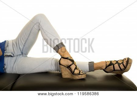 A woman laying down showing off her shoes.