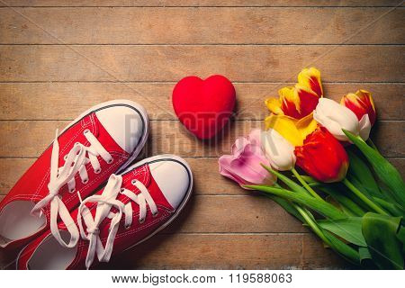 Bunch Of Tulips, Red Gumshoes And Heart Lying On The Table