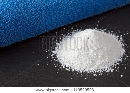 Heap of laundry detergent with blue towel