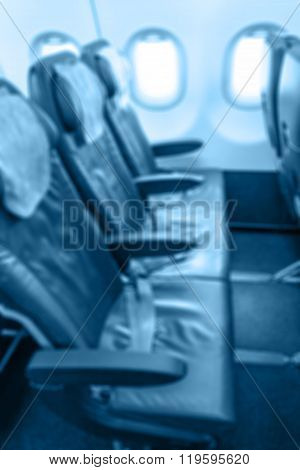 Commercial Passengers Airplane Interior. Blue Tone