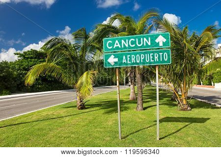 Traffic Sign Airport Or Cancun With Arrows On The Street At Hotel Zone