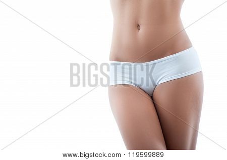 Cheerful young woman is boasting with her body