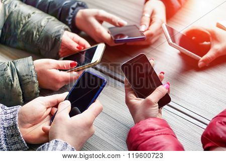 Group Of Friends Having Fun Together With Smartphone - Closeup Of Hands Social Networking