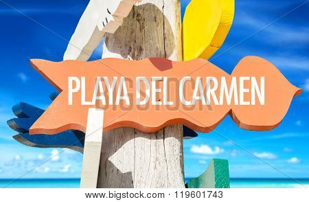 Playa del Carmen welcome sign with beach background