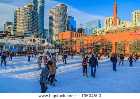 People skating at Harbourfront Centre public skating rink