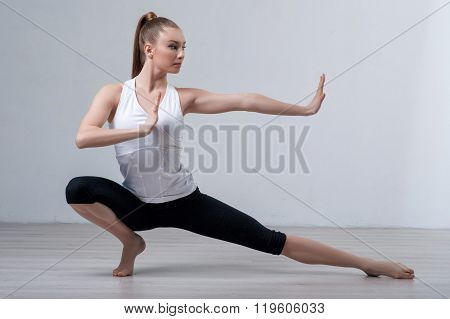 Cute young girl is warming up her body