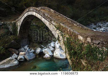 Old Roman bridge in Italian mountains