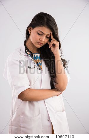 Closeup portrait, young depressed woman healthcare practitioner holding face in despair, isolated ho