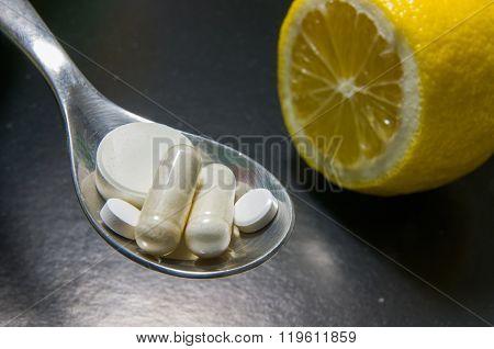 Pills In A Spoon Versus Lemon