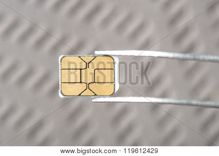 closeup very small Nano SIM card for smart phone