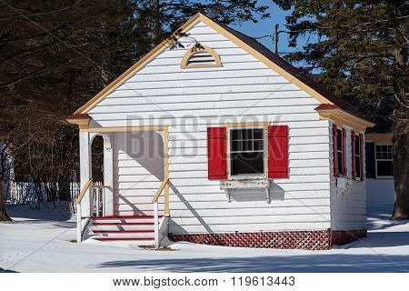 Tiny cottage in the snow.
