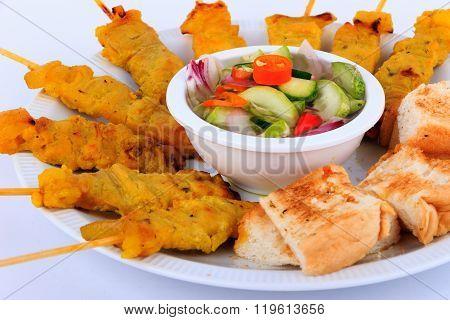 Thai food, Grilled pork satay with peanut sauce and toast.