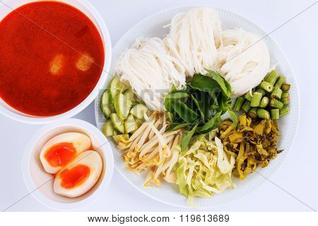Vermicelli solution and fish curry coconut milk with vegetable. (Kanom Jeen Nam Ya)