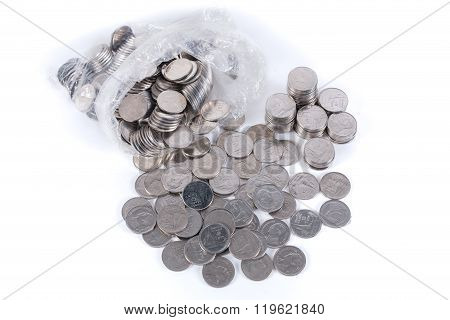 One Baht Coins In Plastic Bag, Coins Stacks And Heap Of Coins  Isolated On White
