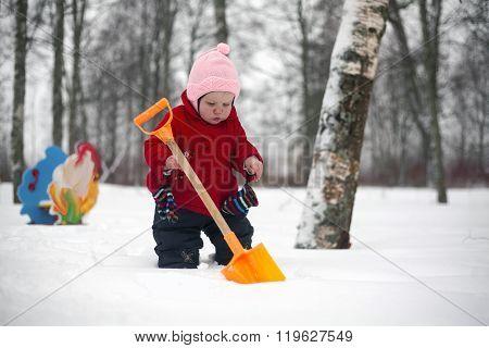 Little Girl And Toy Shovel