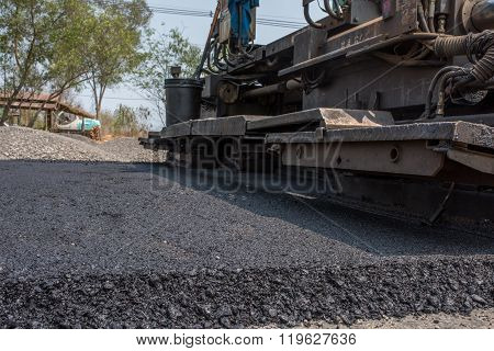 In flexible pavements the upper layer consists of asphalt concrete that is a construction aggregate with a bituminous binder. The wearing course is typically placed on the base course