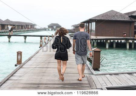 Couple On A Beach Jetty