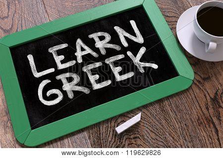Learn Greek Handwritten by white Chalk on a Blackboard.
