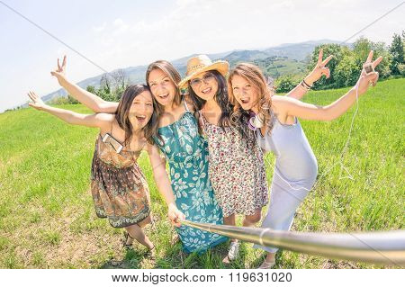 Multiracial Girlfriends Taking Selfie With Stick At Country Picnic - Happy Friendship Fun Concept