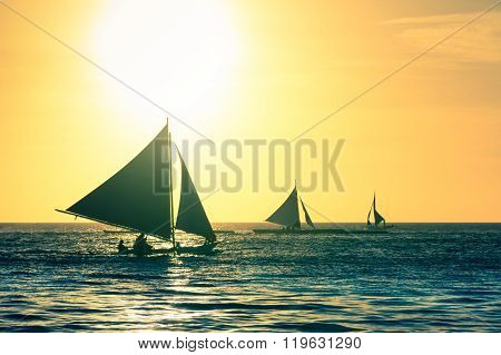 Silhouette Of Typical Sailing Boats At Sunset In Boracay Island - Exclusive Travel Destination In Ph