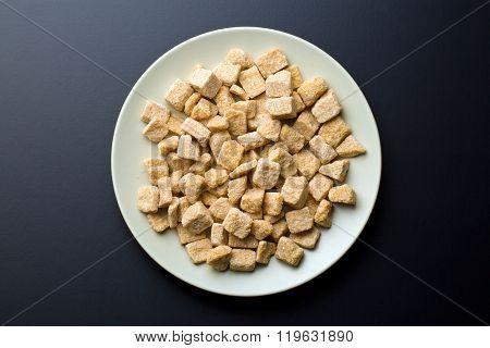 unrefined cane sugar on a plate