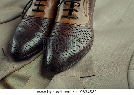 Brown Man's Shoes And Jacket