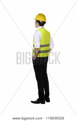Back View Of Asian Worker Wearing Safety Vest And Yellow Helmet