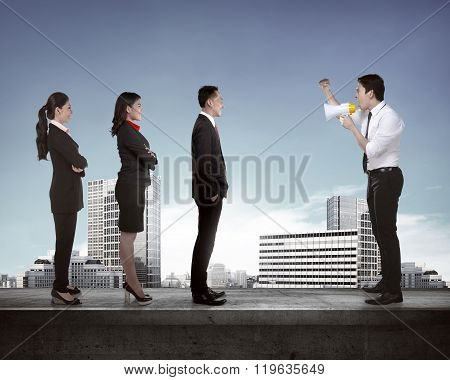 Leader Give Order Via Megaphone To His Subordinate