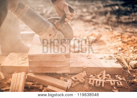 Industrial Worker On Construction Site, Working In Debris And Dus, Sawing And Chopping Bricks