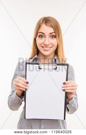 Successful Pretty Woman Demonstrating A File In A Folder