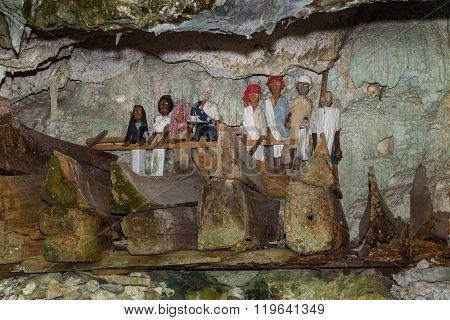 Tana Toraja, Indonesia - Dec 08, 2015: Wooden statues of Tau Tau and coffins in Tampang Allo burial cave of the royal family. Tana Toraja. South Sulawesi. Indonesia