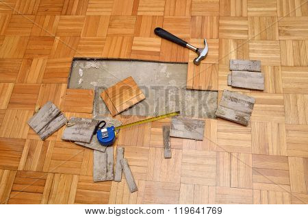 Damaged Parquet And Tools