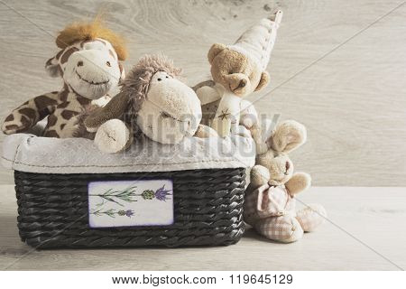 Toys in a wicker basket on the table