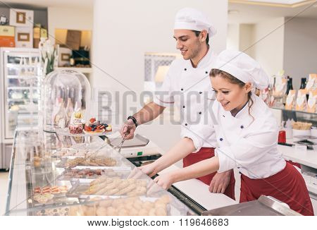 Happy Employer And Business Woman In A Pastry Shop