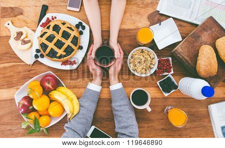 Couple Having Breakfast In The Morning At Home