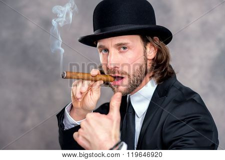 Businessman With Bowler And Thumb Up Smoking Big Cigar