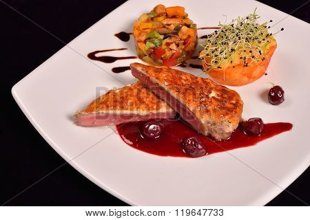 Duck Breast In Parmesan Crust, Cranberry Sauce And A Ratatuille Vegetables (eggplant, Peppers, Zucch