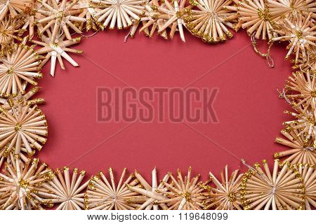 Christmas Background With Golden Straw Stars On A Red Background. Greeting Card With Blank Space