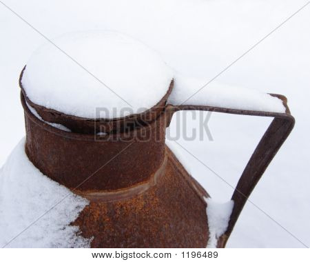 Rusty Snow Covered Milk Can
