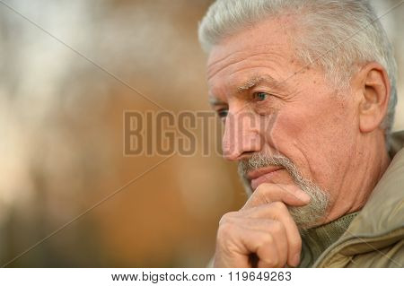thoughtful senior man  in  park