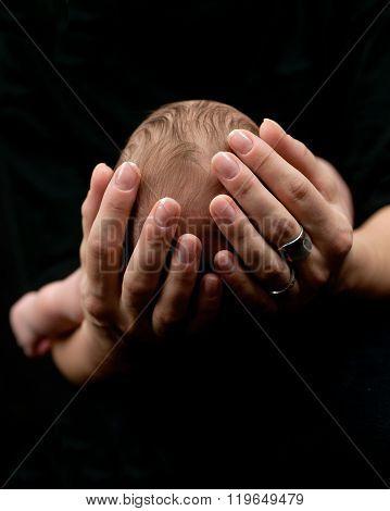 Newborn details on black background