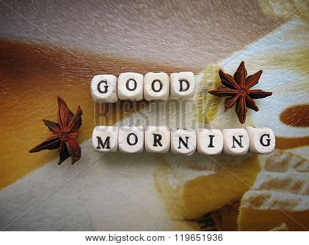 Good morning! - Small wooden cubes and star anise on a light background