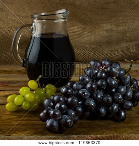 Bunch Of Grapes And Wine Jug