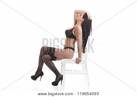Woman In Underwear On A Chair