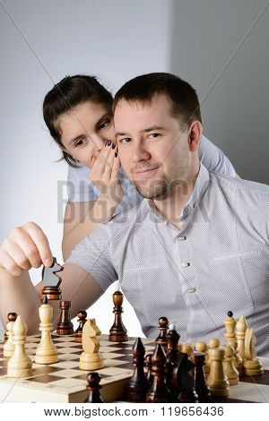 Woman Tells A Man How To Play Chess
