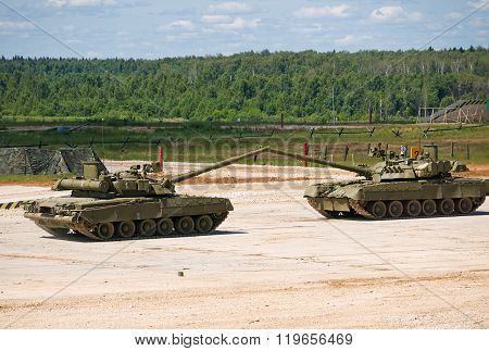 Tanks T-80 facing each other with their guns
