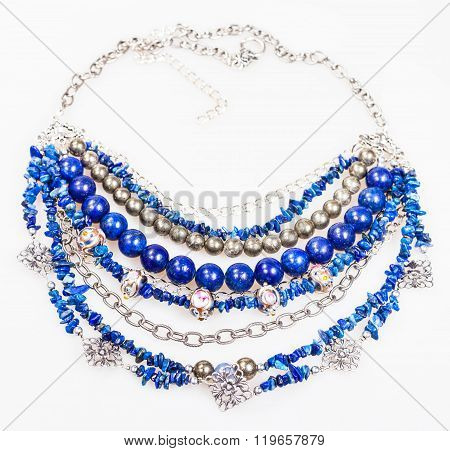 Blue Necklace From Natural Gemstones On White