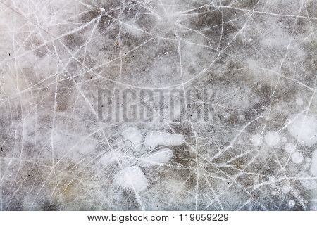 Cracked Ice On Frozen Puddle In Winter